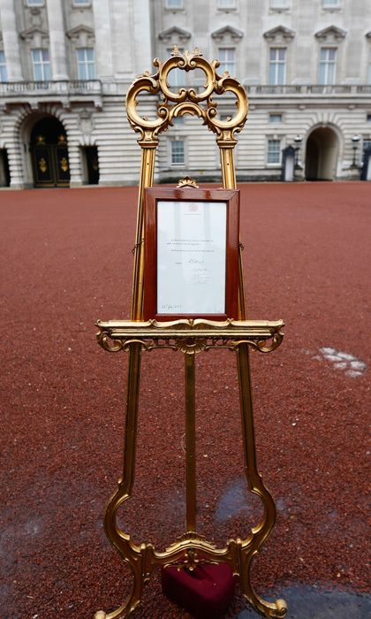 E: EASEL  Even though news of the birth will be shared on Twitter first, the arrival of the fourth in line to the throne will be formally announced in a more traditional way: with a notice placed on a gilded easel outside Buckingham Palace. When George was born in 2013, the document was signed by the medical staff who helped with the birth and then reviewed by the Queen. Photo: © Dan Dennison/Getty Images