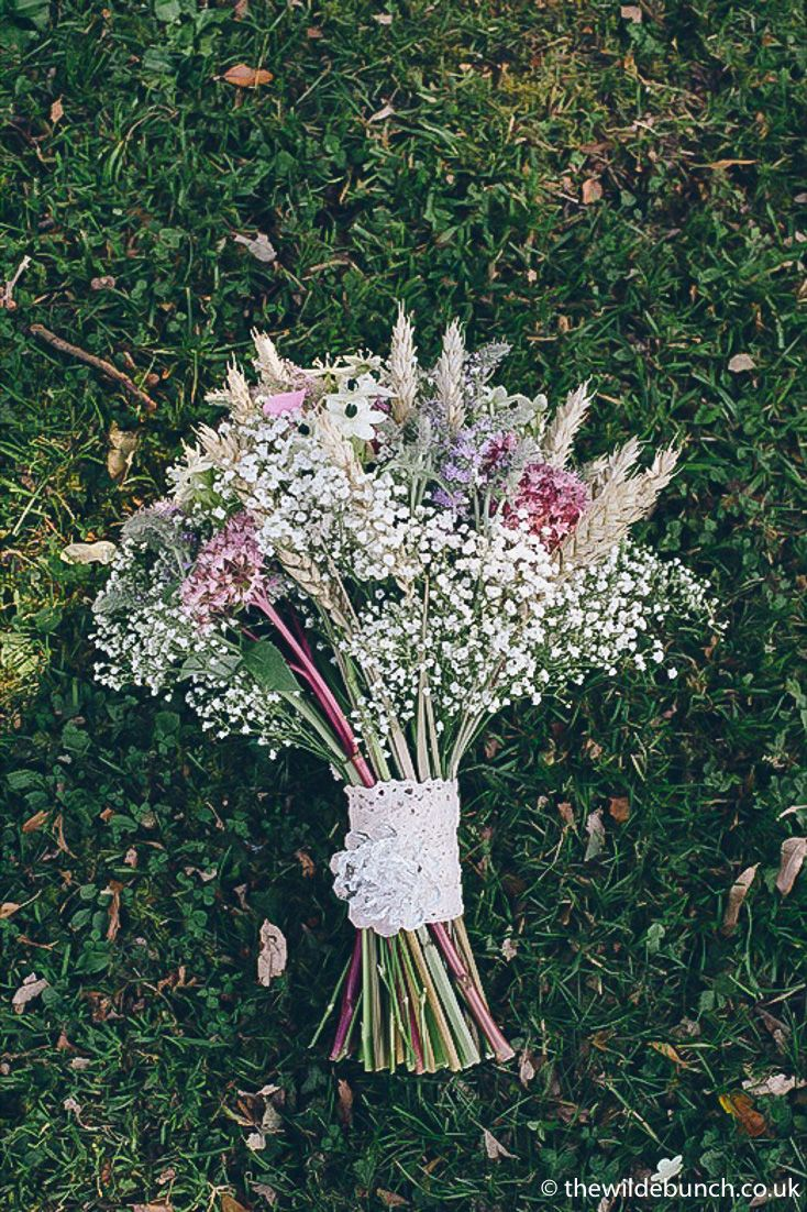 One of the most iconic Rustic Wedding bouquets on Pinterest. With thousands of 'Pins' and featured on the boards of Rustic wedding designers worldwide (Grrrr Pinterest) It's actually a Wilde Bunch Rustic bouquet for the wedding of Jodie & James at Colehayes Park in Devon from Sept 2012.  Using Corn, Lavender, gypsophila, chintz and garden flowers.