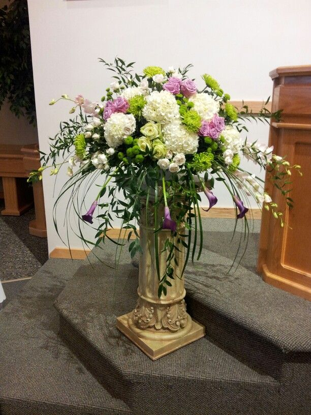 Voluptuous altar arrangement of Hydrangeas, Orchids, Callas, Roses and Mums