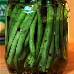 Crisp Pickled Green Beans: I added sliced jalapenos in the jar before adding the beans & brine.