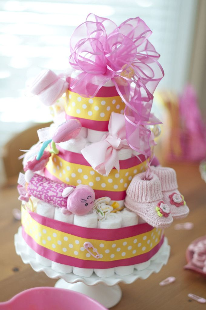 First and second time moms alike can never have enough of one thing: diapers, diapers, and more diapers. Help get the mom-to-be ready for baby #2 by stocking up on all of the newborn essentials she'll need in the form of this amazing DIY diaper cake. This homemade sprinkle or baby shower gift idea may look complicated, but we promise it's easy peasy. Now, let's get our sprinkle shower partying on!