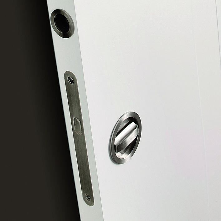Detalle cierre puerta corredera interior puertas - Cierre puerta corredera ...