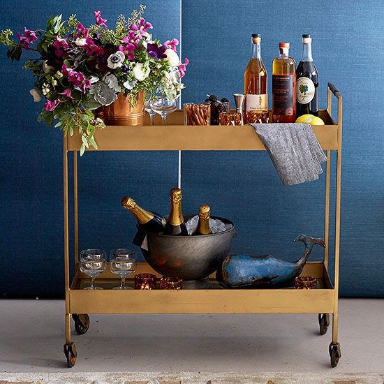 A well-stocked bar cart is the heart of this holiday party. Our picks? Plenty of champagne on ice, liqueurs, and garnishes like cinnamon sticks and fresh fruit.