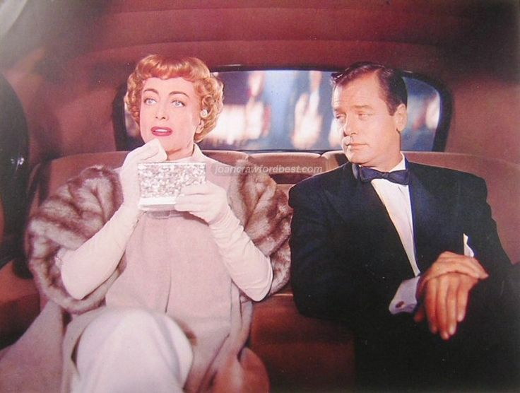 "Joan Crawford with Gig Young in ""Torch Song."""