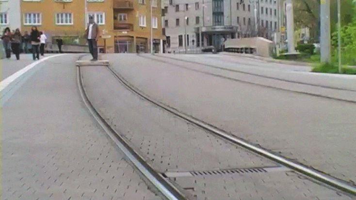 tomas moravec hacks a wooden pallet to glide down tram tracks - designboom | architecture