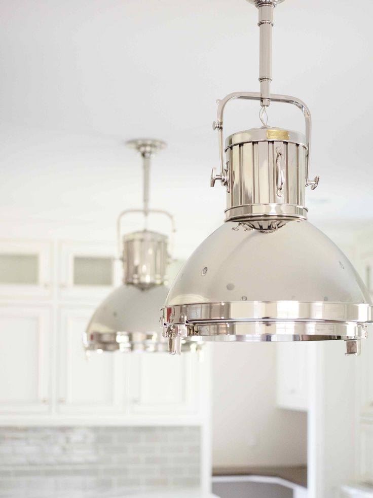 these ralph lauren montauk xl pendant lights hang over the island of an all white kitchen thatu0027s perfect for a coastal kitchen dcor