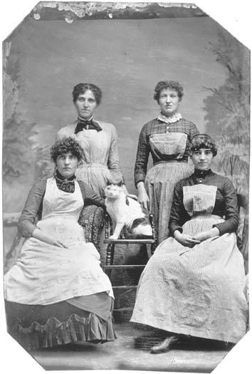 ca. 1865, [tintype portrait of four women posed with a cat] via the Smithsonian Institute, Photographic History Collection > I just get a kick out of this photograph; the cat in the middle, seems to be the 'most important' thing. lol / via tumblr