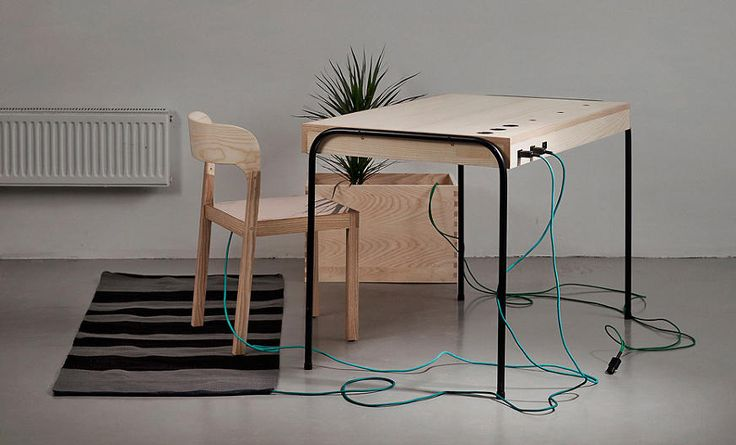 A Green Desk Powered By The Person Sitting At It