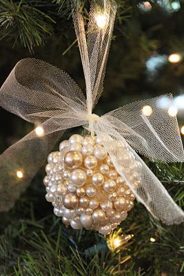 You need:  Inexpensive bulbs from the dollar store  Many many pearls and other crystal beads if you desire  (I used pearls from a couple of broken necklaces that I had. Use about 70 pearls to cover one bulb.)  Hot glue gun  Tulle to string through the top