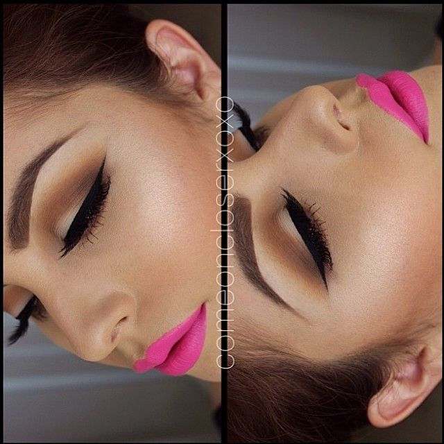 We love this smokey brown eye shadow with heavy black winged liner and a bright neon pink lip #makeup #SS15...x