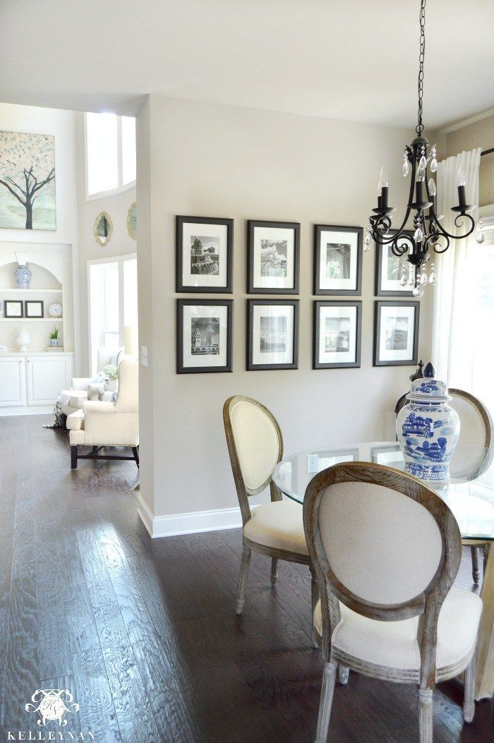 Kelley Nan: Black and White Travel Gallery Wall and Other Gallery Wall Ideas- Sherwin Williams Perfect Greige; Floors- Nottaway Hickory in Weathered Saddle;Chairs- Page Round Back from World Market, Neutral Breakfast Rooom Nook with Ikea Ritva Curtains; Blue and White Ginger Jar