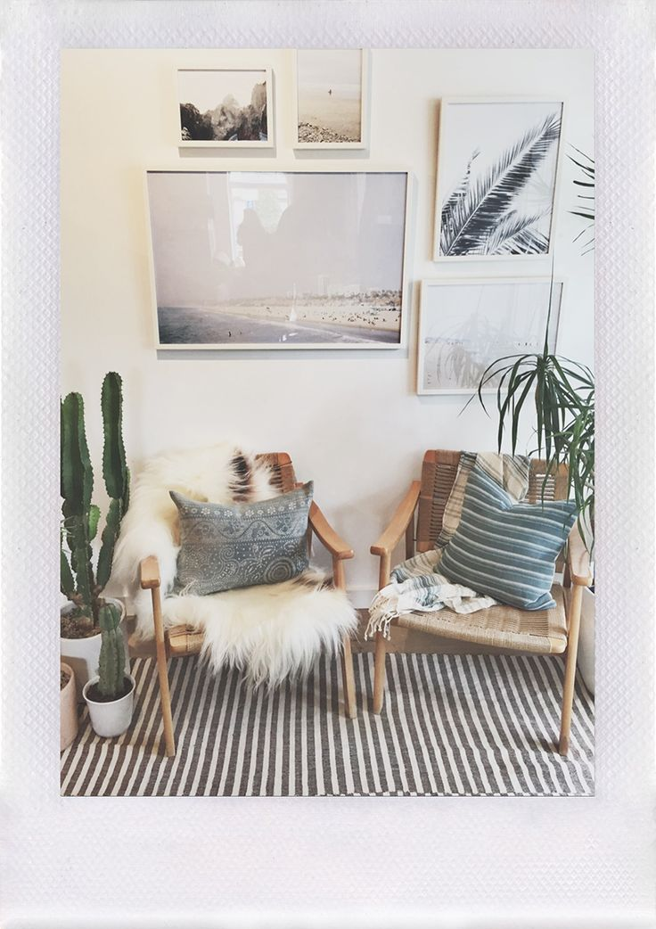 Boho chic gallery wall featuring prints and photographs in white frames and no matting -- so modern and sleek.