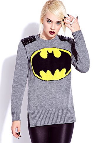 This Batman sweater for women uses some of the classic colors associated with the DC superhero, gold, black, gray, and combines them into a classic and cozy sweater .