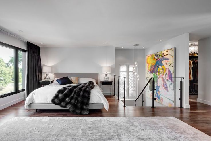 The dwelling features contemporary decor and a variety of materials, such as marble counters and wooden flooring
