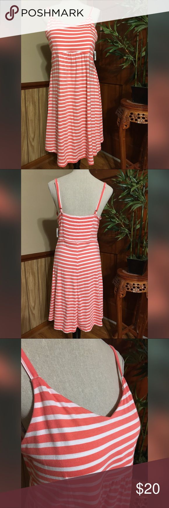 "NWT Old Navy Striped Maternity Dress NWT Old Navy Maternity Dress Size Medium • Striped • Coral Orange in Color • adjustable strap • below knee length  • Nice and super comfy  • 60% Cotton 40% Modal  Approximately Size measurement: Chest (armpit to armpit): 17"" Length (armpit to bottom hem): 28""  ""All Item Come From Smoke Free / Pet Free Home""   Buy with confidence:) Old Navy Dresses"