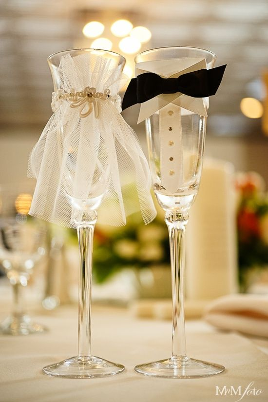 """""""Bride and Groom"""" Champagne Glasses - MEG!!!! We could totally make these with cheap champagne glasses. Could even make them for the bridesmaids and groomsmen too! :)"""