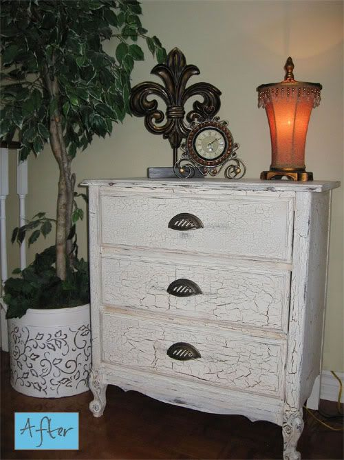 This is the look you get after you paint it with (crackle paint)...There's blue under neath and it slips in through these cracks..making a regular modern dresser look vintage..