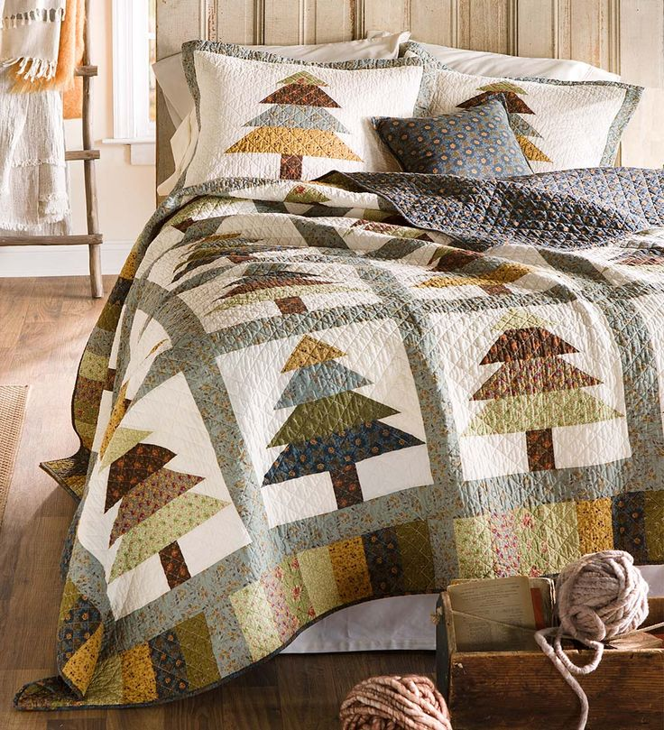 Evergreen Forest Quilt Set | Evergreen trees adorn this rustic patchwork quilt in a forest of green, gold and blue. It lends country charm to any bedroom.