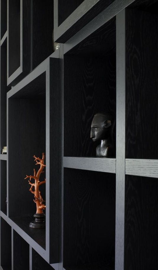 Piet Boone makes magic happen with shelving   black modern bookcase   custom buil-ins