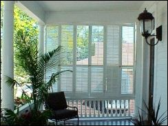 shutters for screened porch   This formal porch incorporates a set of tall wooden shutters to create ...