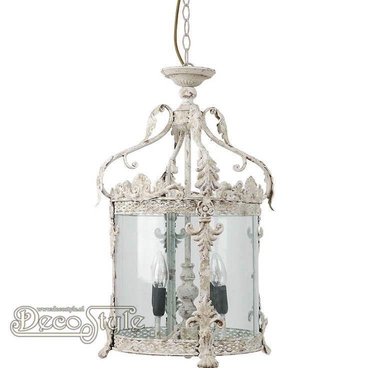 Brocante Hanglamp Zarah Metaal Beige  Metalen ronde brocante hanglamp. De zijkanten voorzien van glas. Met 4x Kleine fitting (E14).   Kleur: Beige natuur tinten  Afmetingen lamp zonder ketting: Hoogte: 58 cm Breedte: 32 cm Diepte: 32 cm  Hoogte met ketting: +/- 140 cm