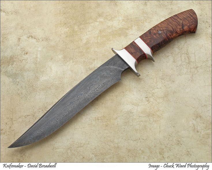 This beautiful blade is Delbert Ealy's random pattern damascus.  Fittings are stainless steel, handle is curly koa. Approx. $1,800. David Broadwell original.