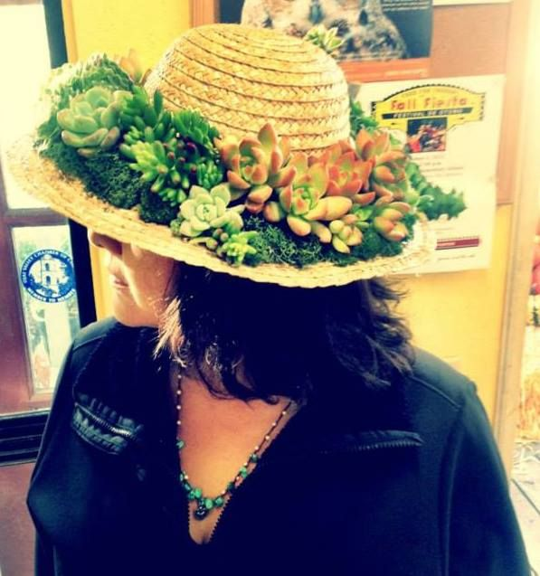 Carolina, the owner, donning a succulent hat made by Kym!