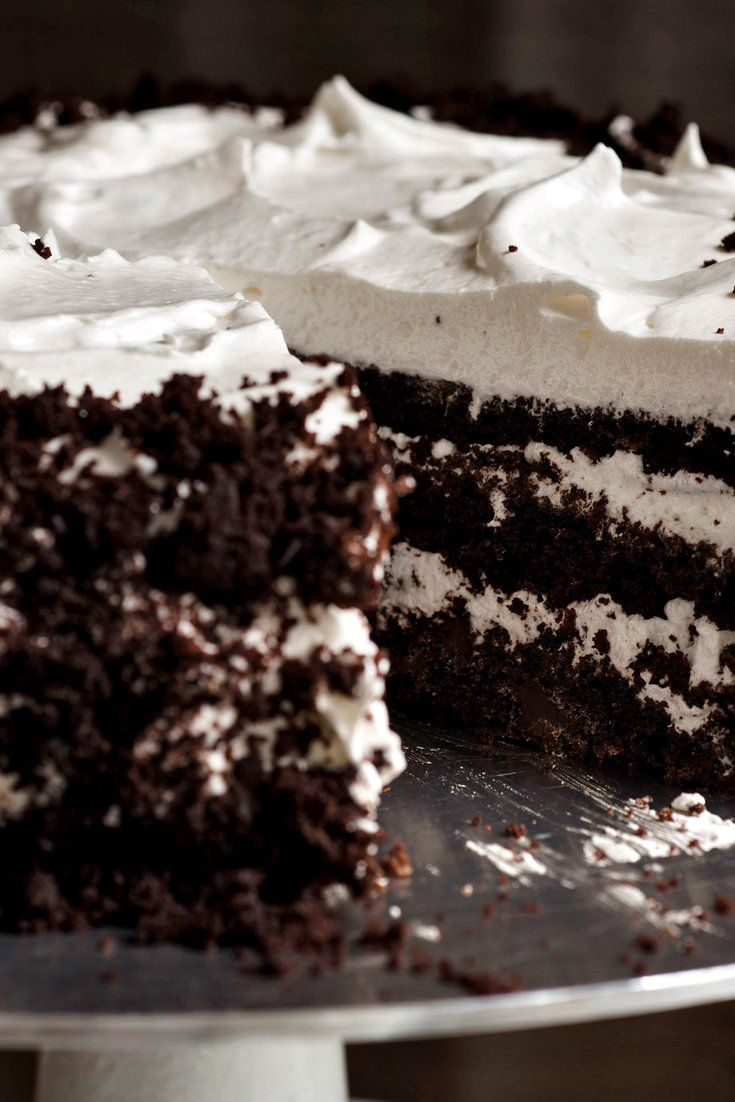 The cake is three layers of devil's food with a fourth one crumbled over the icing, artfully if your cake is neat, desperately if it's not. Crumb topping is a great mask for many of the aesthetic problems a cake might have. (Photo: Karsten Moran for The New York Times)