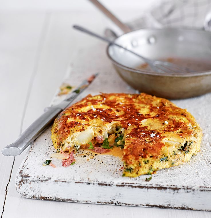 Make clever use of time-saving ingredients with this speedy herby potato and ham tortilla.
