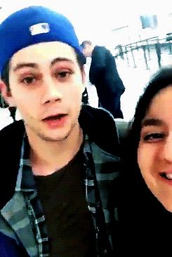 Dylan at LAX with a fan on March 7, 2016 . Dylan O'Brien is heading to Vancouver. Filming The Death Cure! gif