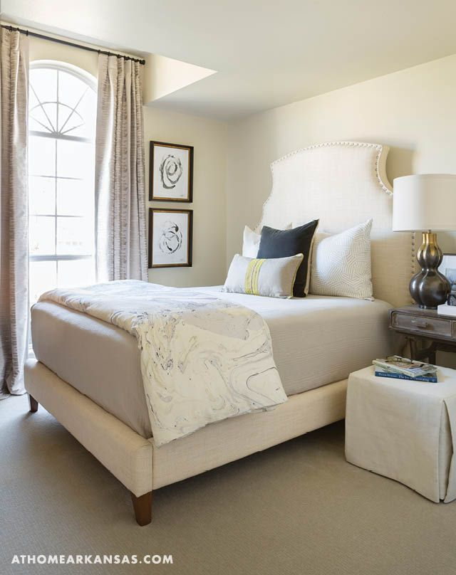 A neutral guest bedroom is equally suited