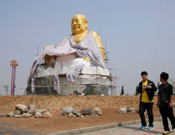 Sometimes the statues are meant to be light-hearted, like the massive Buddha statue in a Luoyang amu... - Reuters