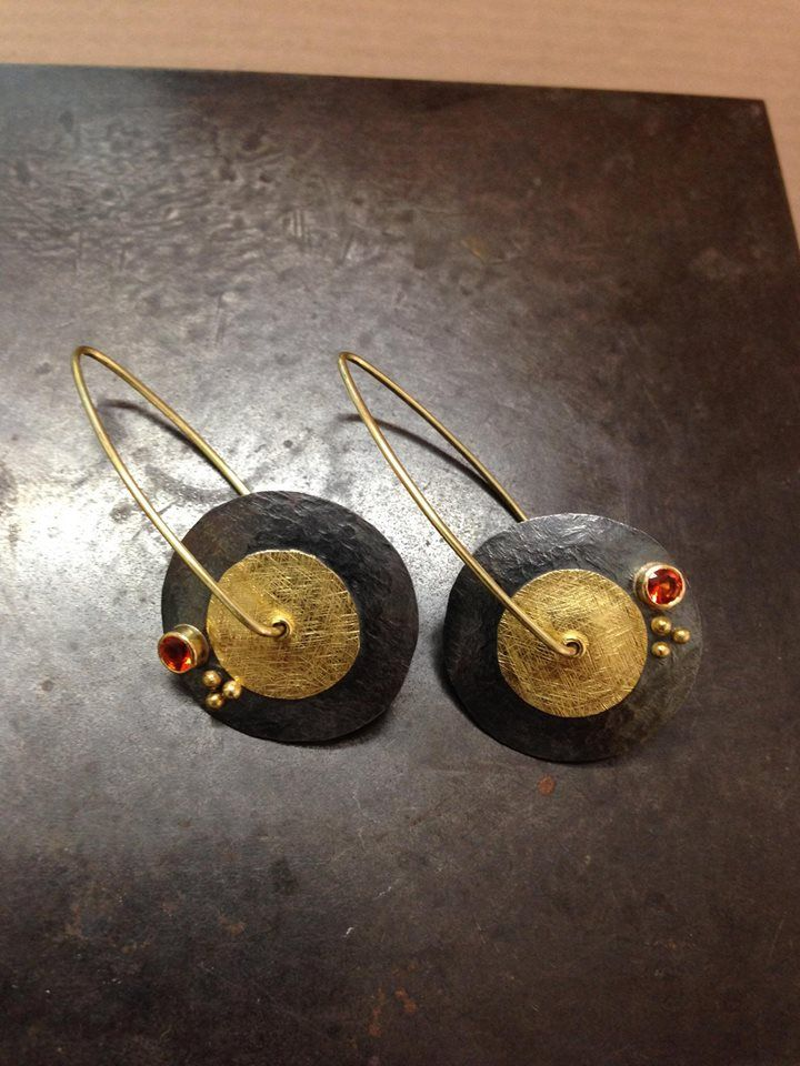 Ormachea Jewelry. Ormachea Jewelry Hugo created this contemporary style of earrings, handcrafted in gold and blackened silver and highlighted with red sapphires and granulations...practical for everyday use!