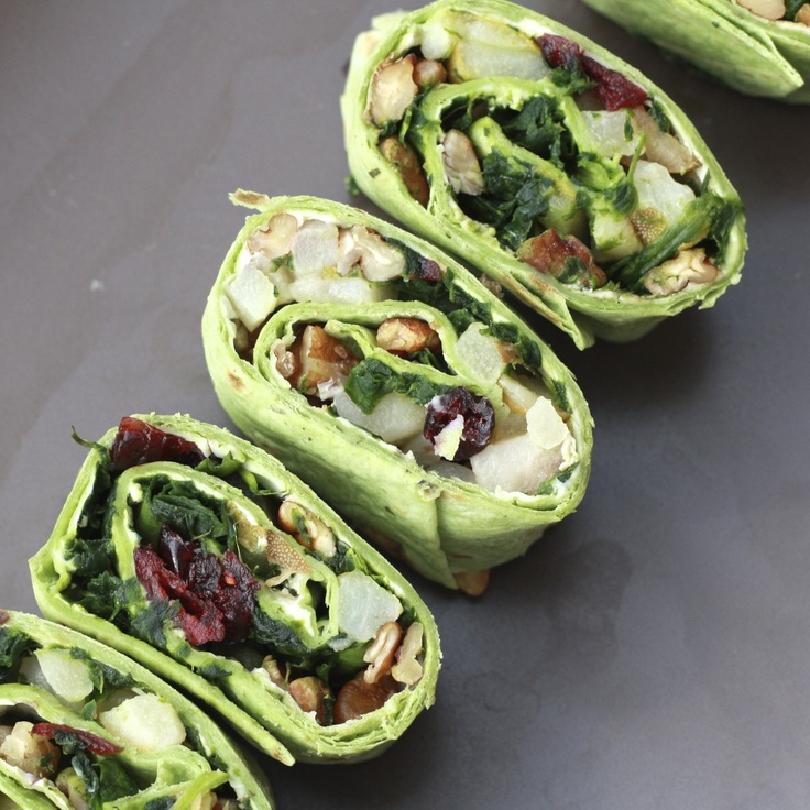 Spinach, Pear, Pecan and Cranberry Pinwheels.  -1 package pesto-flavored tortillas (6 ct)  -5-8 oz. light cream cheese, softened (depends on how much cream cheese you like on there)  -2 pears, diced small  -1 oz. butter  -pecans, chopped  -2 cups spinach, chopped into small pieces  -dried cranberries