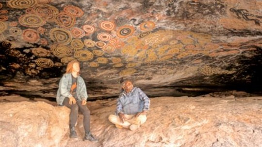 Cave Hill, in the Pitjantjatjara Aboriginal Lands of Central Australia. Dickie Minyinteri began his painting career as a custodian of the magnificent rock art paintings of the Seven Sisters creation story.