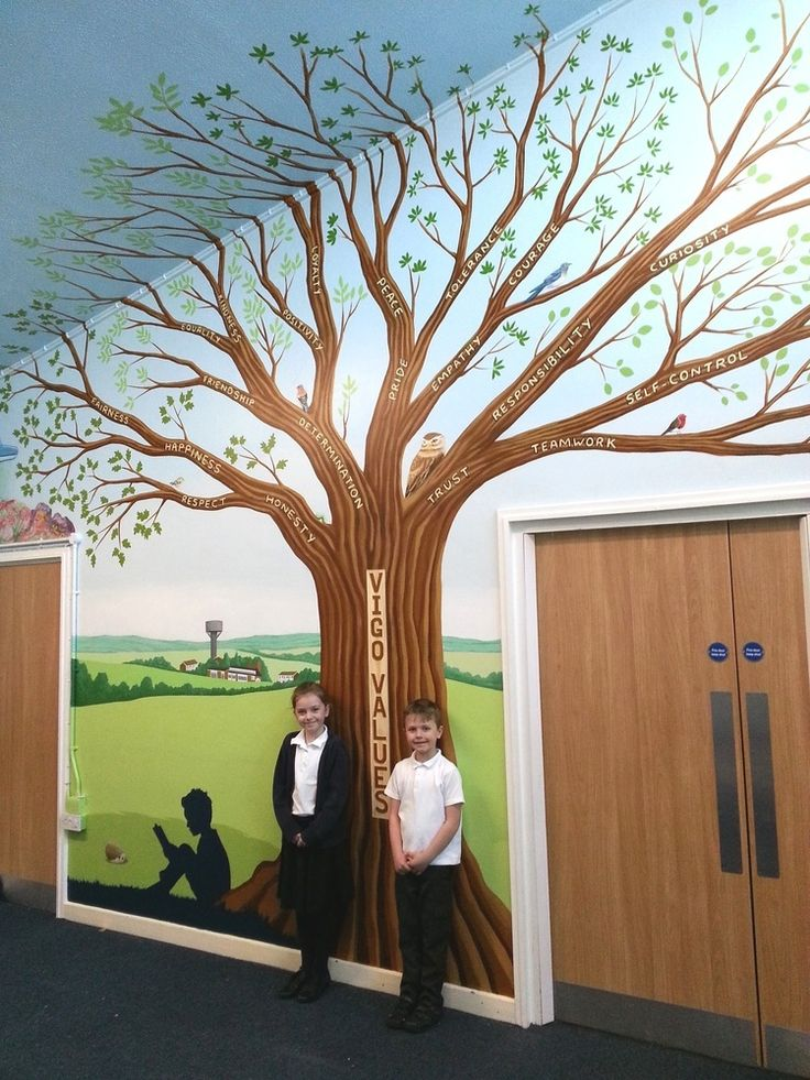 This large tree mural was painted in the entrance hall of Vigo Village Primary school. On each of the branches a different 'Vigo Value' word is written, and there are four types of leaves painted onto the tree to represent each of the school houses. We also painted various animals in the tree which correspond to the names of the school classes. In the background you can see the school building painted, with the iconic Vigo water tower also featured.