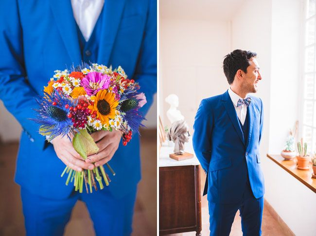 Love the contrast of the groom's blue suite and the warm coloured bouquet. Photo by Marion Huerteboust.