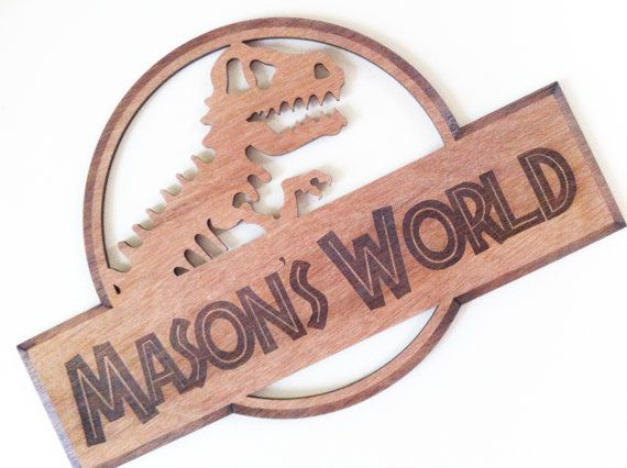 Jurassic Inspired Wooden Sign  Add that personalised touch to your childs room with our Jurassic Inspired Wooden Sign.  Sign measures approximately 340mm x 230mm and cut out of 4mm plywood. Due to the natural properties of timber, colour variations will occur.  Our Jurassic wooden signs will be finished with varnish.  Why not click on over and check out our matching 3D Wooden Puzzles.