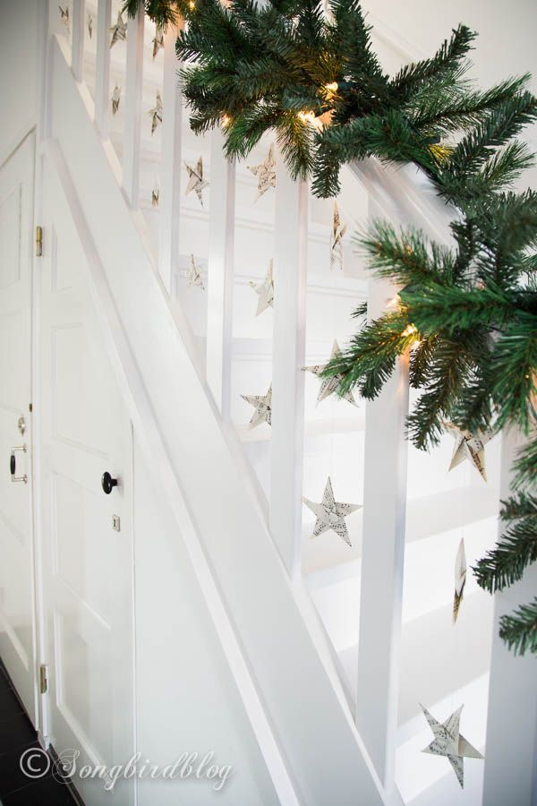Staircase with garland and folded music sheet stars. (Christmas staircase garland-7