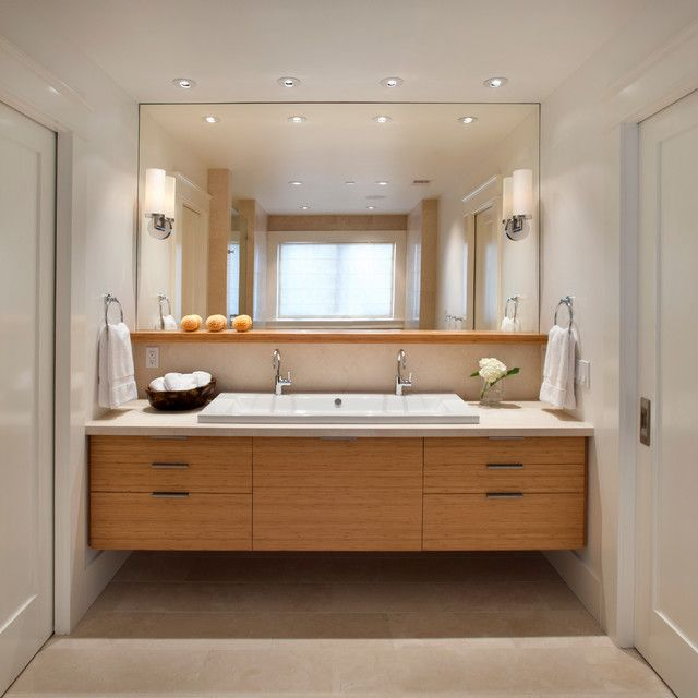 Contemporary Art Websites Like this vanity ensemble Frameless mirror floating vanity one trough sink with two fixtures instead of double sinks The shelf below the mirror
