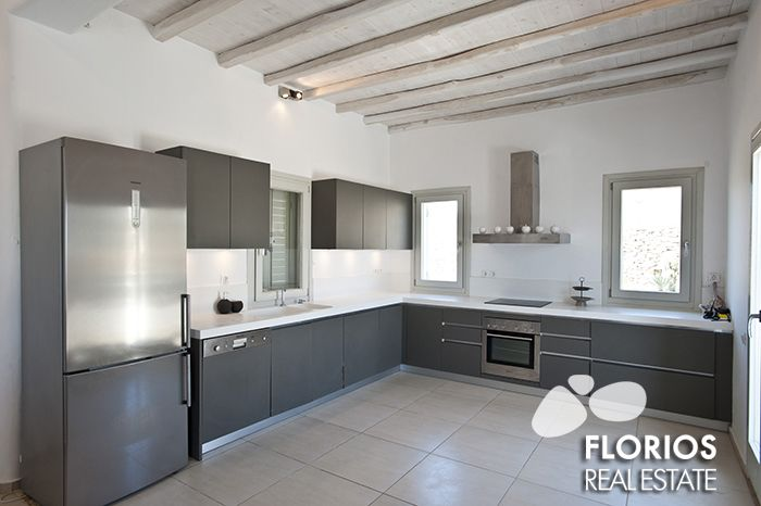 The modern fully-equipped kitchen on the ground level of the Villa for Sale FL1486 on Mykonos island Greece. http://www.florios.gr/en/mykonos-property/9.html