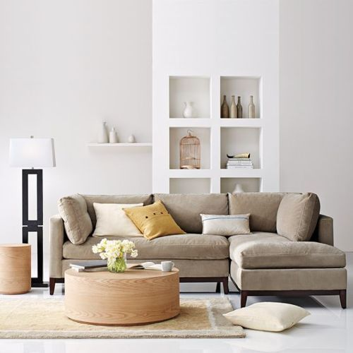 L shaped couches just make you want to cozy up in a family room. Throwing some nice pillows on it creates a cushy vibe