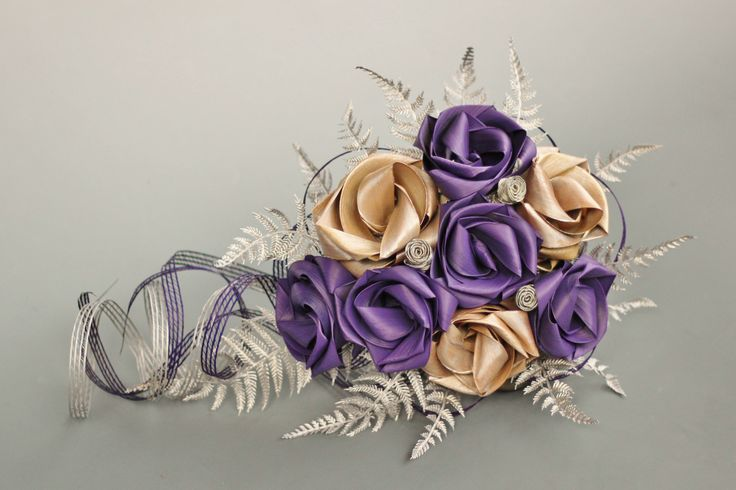 Waterfall bouquet in mid purple and pearl white with trailing loops and silver fern. www.flaxation.co.nz