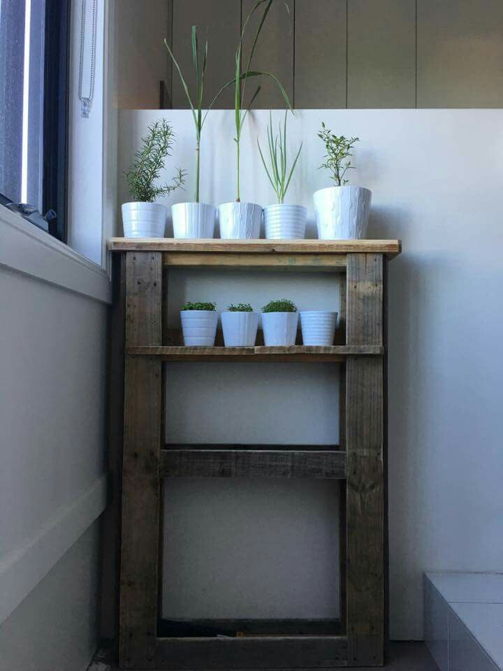 A customized pallet shelf for a customer's herb pots.