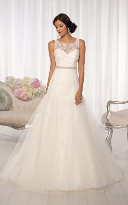 Breathtaking designer Essense of Australia wedding dress offers a slim A-line frame with a stunning illusion Lace neckline and back. (Style D1615)