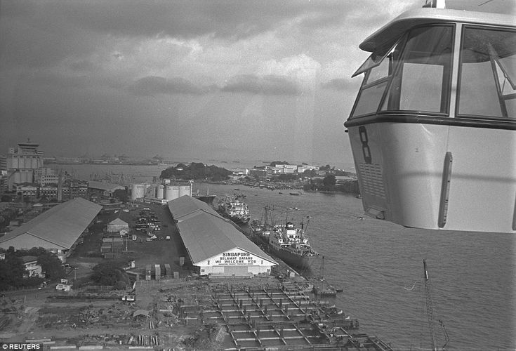 A view of the port of Singapore and during the opening of the Mount Faber to Sentosa cable...