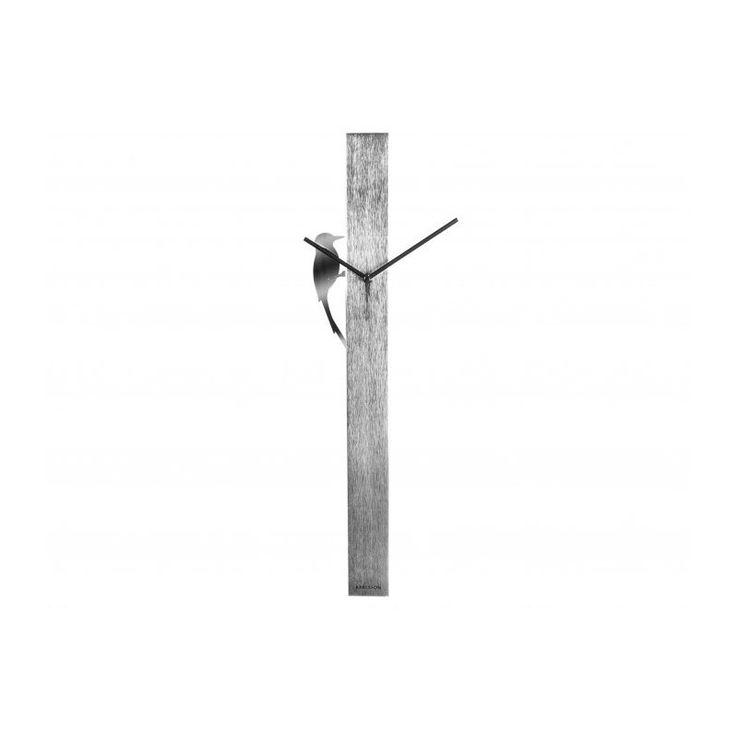 Une horloge façon coucou suisse moderne et design.. Le pic vert rythme les secondes sans faire de bruit. Une horloge coucou design et poétique en inox satiné ou aspect bois.
