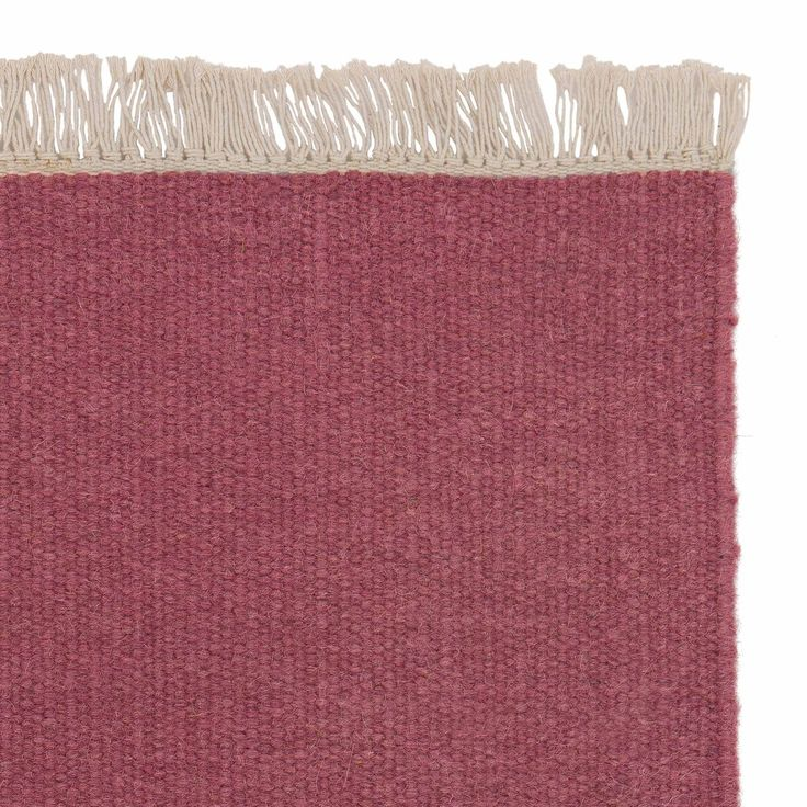 <p>Designed in a palette of striking colours, our Manu Rug is sure to grab your attention. Solid shades are set off by the tightly woven wool and cotton blend on this reversible rug, embellished with a beige fringe. Ethically created by hand in India, the Care & Fair certified Manu has a quality finish that will withstand regular household wear and tear. An adaptable all-rounder available in a range of shades, it's perfect for use in all areas of your home, no matter the decor.</p> <p>Te...