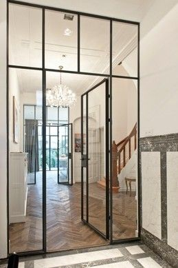 Tochtportaal met stalen deuren, J.J. Viottastraat | Kodde Architecten