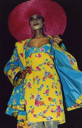Yellow and blue floral-print dress and coat (inspired by painter Kees van Dongen) and wide-brimmed red straw hat, by Frank Govers, spring/summer 1990.